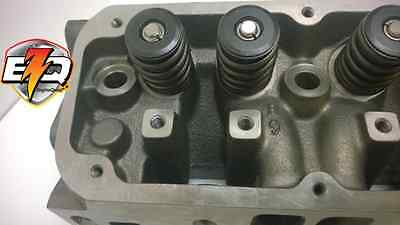 318 / 360 CHRYSLER MAGNUM ASSEMBLED CYLINDER HEAD EARLY L.A. BOLT PATTERN - pair