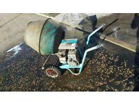 Petrol driven cement mixer.