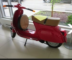 VESPA BIKE WITH FERRARI PAINT AND Seat.