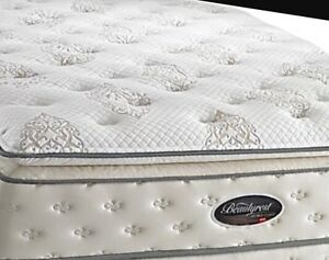 King size plushy beauty rest pillow top mattress. Free delivery