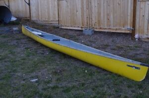 Yellow Canoe for sale 18 feet 6 inches long