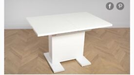 Extendable white gloss dining table