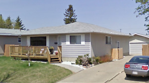 Full house in Patricia Heights with large detached garage.