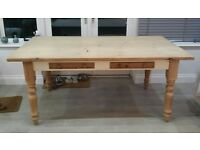 Pine Kitchen Table. Pine table top and legs, with cream painted surround. 2 pine drawers.72x41 x31in