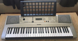 Yamaha PSR-E313 keyboard with weighted foot pedal