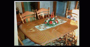 Maple dinning room table and 4 chairs 3 leafs, hutch and buffet