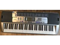 Casio Electronic Keyboard LK-100 With Key Lighting System. and mic input