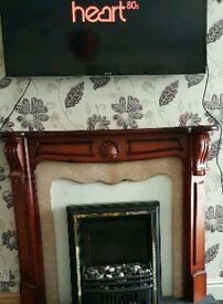 FIRE, WITH SURROUND AND MARBLE BACK.