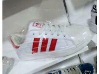 Adidas Superstar red stripes
