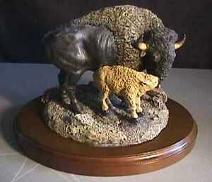 BISON WITH CALF SCULPTURE SIGNED