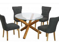 New glass dining table and 4 fabric chairs £299