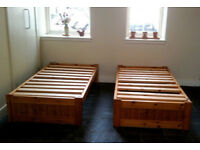Two single pine wood bed frames, complete and versatile in very good condition