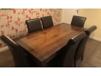 Quality extendable dining table and chairs