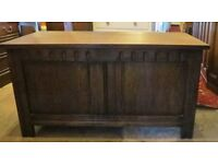Heavy Solid oak carved blanket box / ottoman / toy trunk. Can be used to sit on.