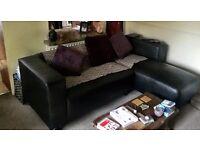 Black leather contemporary corner sofa