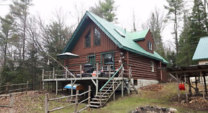 Log home with a great workshop!