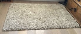 Oatmeal Shag Pile Rug 180 x 120cm. Almost new. Excellent Condition. Collection only.