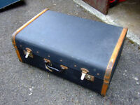 VINTAGE BLUE STEAMER TRAVEL TRUNK WITH WOOD BANDING.
