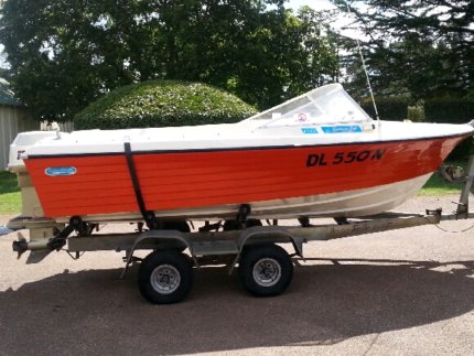 Sportsman craft boat on boogie multi roller trailer