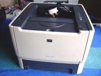 HP P2015 BLACK AND WHITE PRINTER.