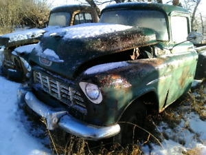 Various antique cars and trucks