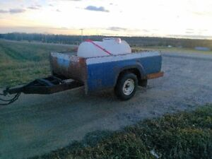Utility trailer and 150 gallon water tank.