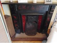 Cast iron fireplace with tiled surround, grate, fire guard and wooden fender