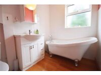 Free standing Victorian style bath and matching taps