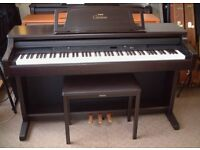 Yamaha Clavinova CLP-860 Digital Piano in rosewood, full size weighted keys and 3 pedals.