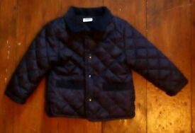 Boys navy blue quilted jacket. 6-9 months