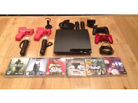 PS3 Slim 2 Dual shock controllers, 2 move controllers & nunchucks with 5 games