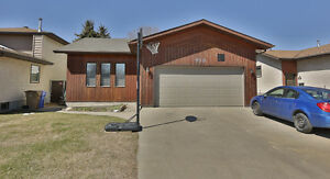 Bungalow with double attached garage in North Regina