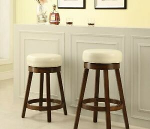 "Padded swivel stools, 3 colors, 24"" counter- $129, 29"" bar- $139"