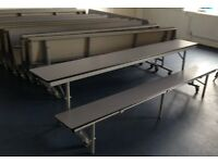 Fold down school dining table and chairs with wheels approx 8ft in length with wheel castors