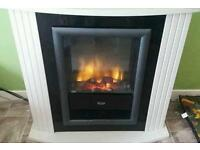Fire surround with built in electric fire