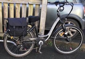Electric bike, 1 year old, comes with suspension, throttle, pannier rack, integrated light RRP £1050