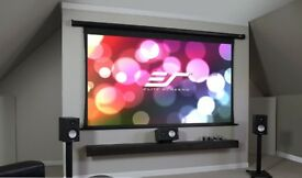 home cinema or gaming setup complete with screen speakers movies etc .