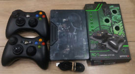 2 Wireless xbox 360 controllers complete with charging stand