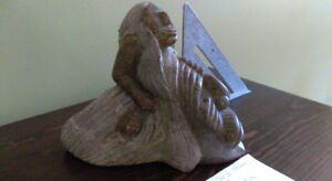 Inuit soap stone carving.