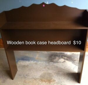 Bookcase headboard for a twin bed and wooden table