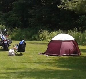 Camping beds, tent, old lamp