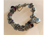 Pandora bracelet with 15 charms and safety chain