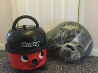 Red Henry Hoover vacuum cleaner
