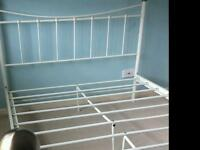 White metal double bedstead