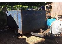 Large wooden trailer with ramp and cover