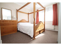 Four poster bed, pine, with four underbed drawers - comes apart for ease of moving