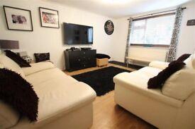 2 x white leather sofa's