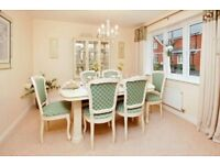 6 seater dining room table & 6 chairs.extends to fit 8 people..excellent condition. Priced to sell.
