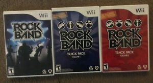 Wii Rock Band CD's, Drums with sticks, Guitar, and Microphone