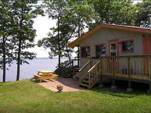 Cosy cottage with private beach on Grand Lake - weekly rentals